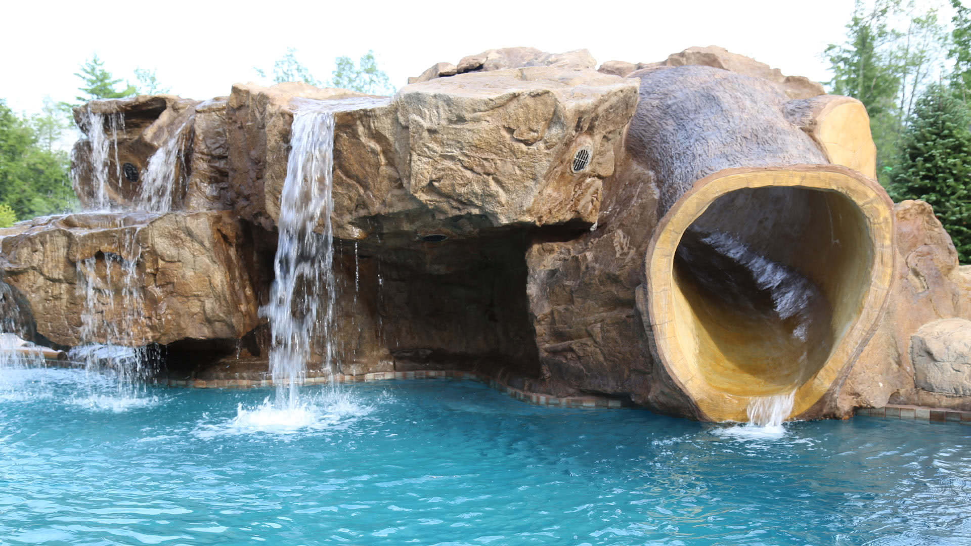 Poolside Water Features Rock Water Slides Waterfalls Grottos Oasis Outdoor Living